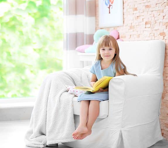 A light armchair in sunny homeschool rooms